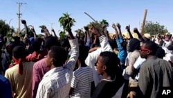 FILE - People chant against the government during a protest in Kordofan, Sudan, Dec. 23, 2018. With violent anti-government protests into their fourth week, Sudan appears headed toward political paralysis.
