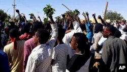 FILE - People chant against the government during a protest in Kordofan, Sudan, Dec. 23, 2018.