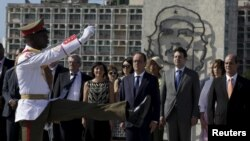 French President Francois Hollande attends a wreath laying ceremony for Cuba's independence hero Jose Marti at Revolution Square in Havana, May 11, 2015.