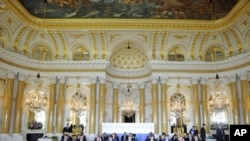Presidents of 20 East and Central European countries attend a plenary session at the Royal Castle in Warsaw, Poland, May 27, 2011. The summit will be joined by US President Barack Obama