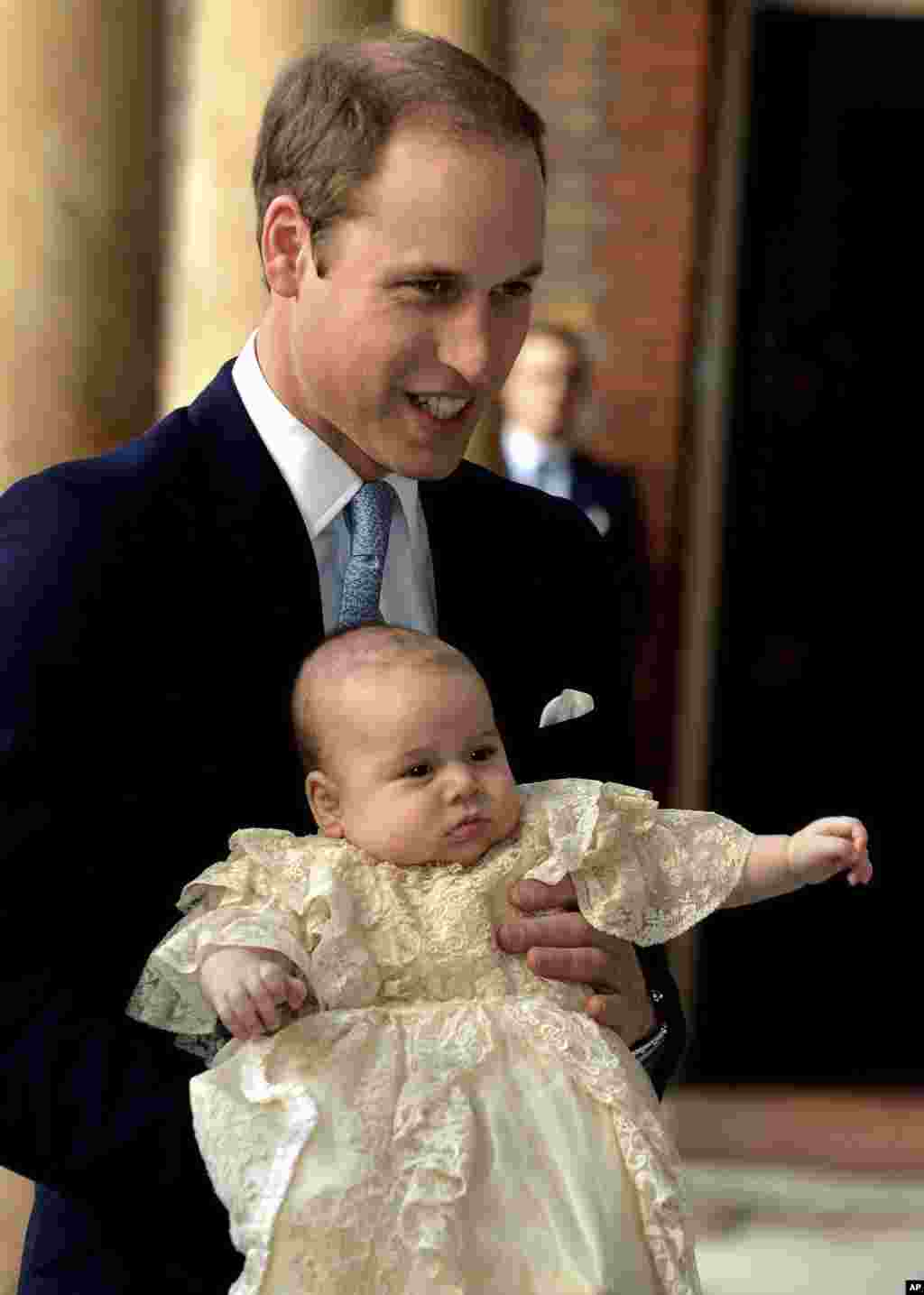 Britain's Prince William, holds his son Prince George as they arrive at Chapel Royal in St James's Palace in London, for the christening of the three month-old Prince, Oct. 23, 2013.