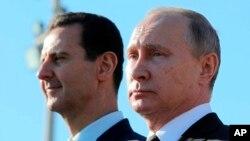 Vladimir Putin va Bashar Assad. Suriya, 11-dekabr, 2017.