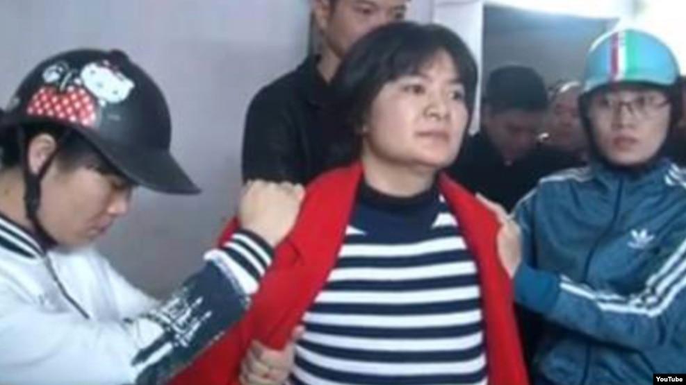 Hình ảnh bà Nga bị bắt giữ hôm 21/1.