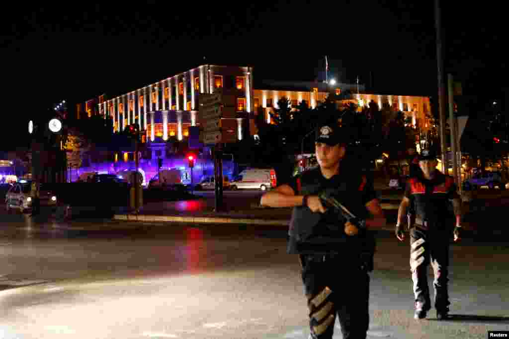 Police officers stand guard near the Turkish military headquarters in Ankara, Turkey, July 15, 2016.