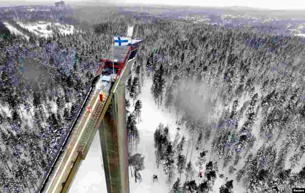 A Finnish flag flies atop the tower of the Lahti Large Skijumping Hill, Finland.