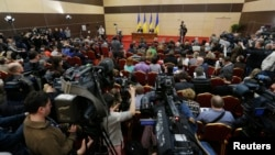 FILE - Journalists listen to ousted Ukrainian President Viktor Yanukovich during a news conference in the southern Russian city of Rostov-on-Don, Feb. 28, 2014.