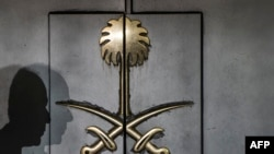 The shadow of a security guard is seen on the entrance door of the Saudi Arabia's consulate in Istanbul, on Oct. 12, 2018.