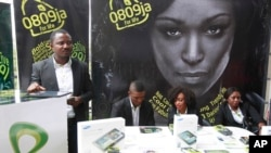 FILE - Staff of Etisalat Nigeria await customers during launch of mobile number portability in Lagos, the commercial capital of a nation that was poised to overtake South Africa as the biggest economy on the continent in 2013.