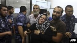Женщина потерявшая сына после авиоудара