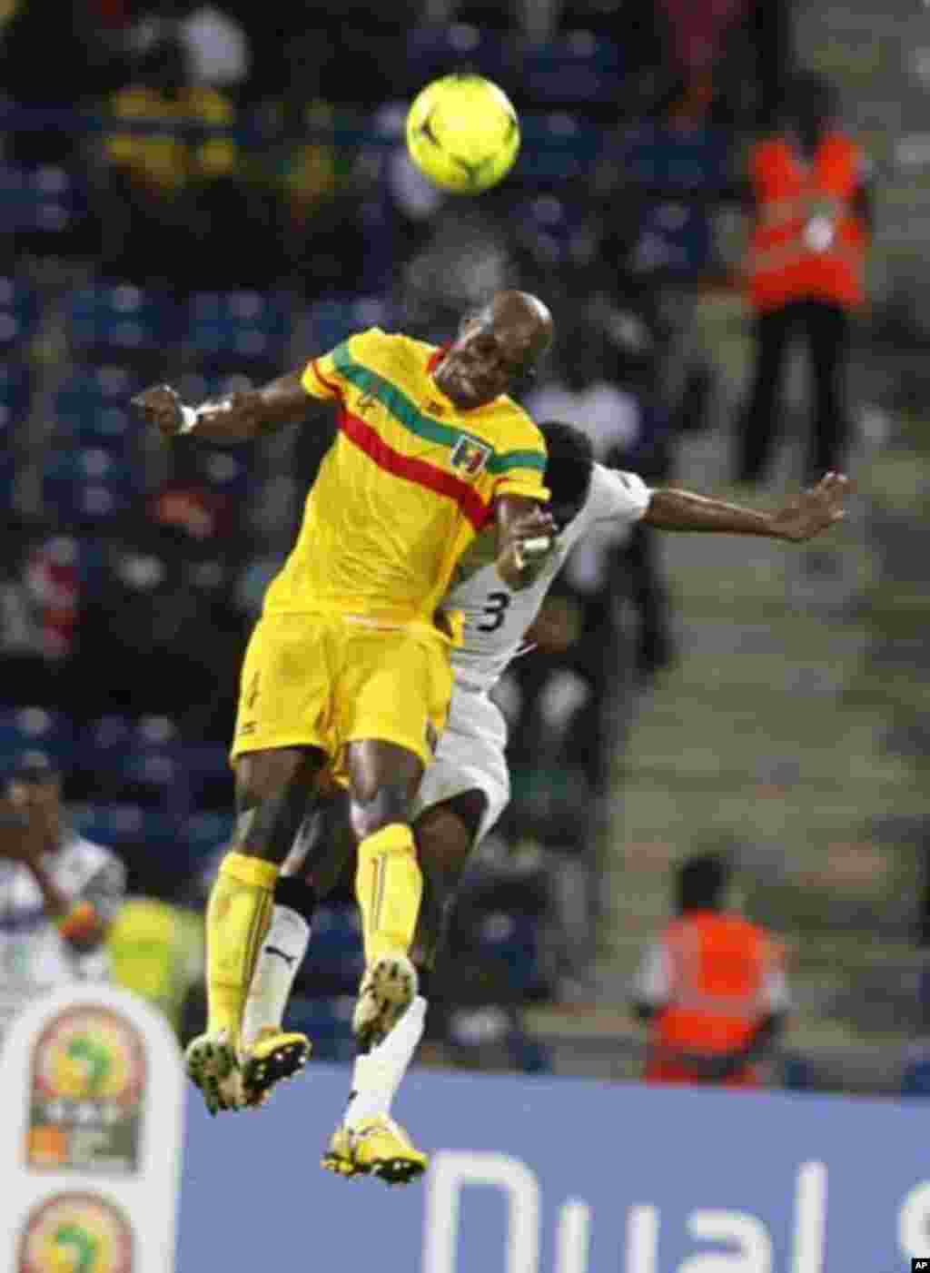 Mali's Berthe Abdoulaye Youssef (L) challenges Gyan Asamoah of Ghana during their African Cup of Nations Group D soccer match in FranceVille Stadium January 28, 2012.