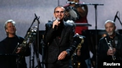 "FILE - Ringo Starr performs ""Photograph"" at the 56th annual Grammy Awards in Los Angeles, Jan. 26, 2014."