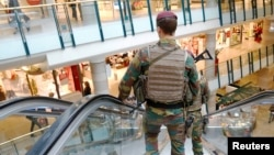 FILE - Belgian soldiers patrol the shopping center City2 in central Brussels, Belgium, June 15, 2016.