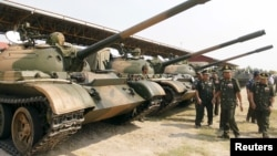 FILE PHOTO - Cambodia's Deputy Prime Minister and Defence Minister Tea Banh (2nd R) inspect tanks inside the Army Institute after a graduation ceremony at Army Institute in Kampong Speu province on March 12, 2015. (REUTERS/Samrang Pring)