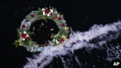 A wreath floats after being thrown into the sea during a service of remembrance aboard the Titanic Memorial Cruise, over the Titanic disaster site 100 years after it sank in the western Atlantic Ocean April 15, 2012.