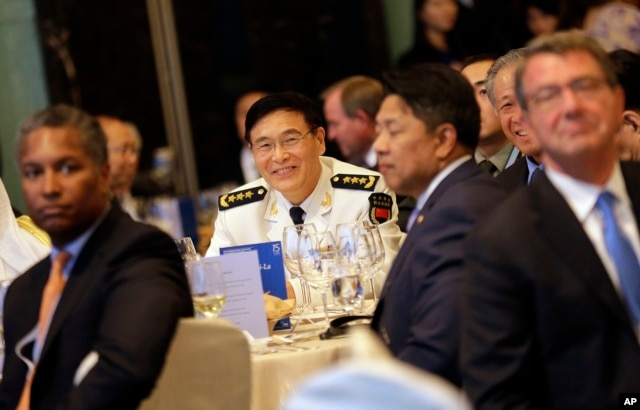 China's Joint Staff Department Deputy Chief Adm. Sun Jianguo, center, attends the Opening Dinner of the 15th International Institute for Strategic Studies Shangri-la Dialogue, or IISS, Asia Security Summit, in Singapore, June 3, 2016. U.S. Defense Secretary Ash Carter is at right.