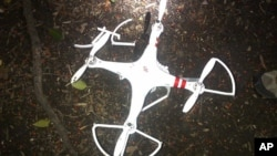 FILE - This handout photo provided by the US Secret Service shows the drone that crashed onto the White House grounds in Washington, Jan. 26, 2015.