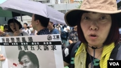 香港市民徐小姐參與8月31日灣仔修頓球場的祈禱會,希望以宗教的力量爭取反送中民間5大訴求,缺一不可。(攝影: 美國之音湯惠芸)