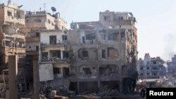 Gedung-gedung rusak dampak dari serangan oleh kekuatan yang setia kepada Presiden Suriah Bashar al-Assad. Daraya, Suriah.