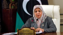 Libyan Tourism Minister Ikram Abdusalam Bash Imam speaks during a news conference in Tripoli, July 16, 2013.