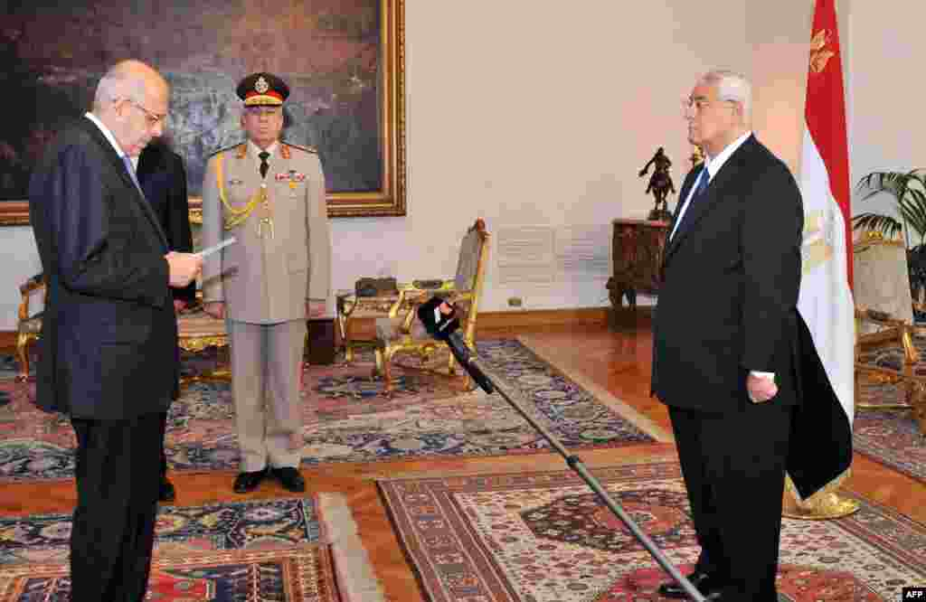 This handout photo shows Mohamed ElBaradei being sworn in as Egypt's interim vice president for foreign relations, in front of Egypt's interim president Adly Mansour, Cairo, July 14, 2013.