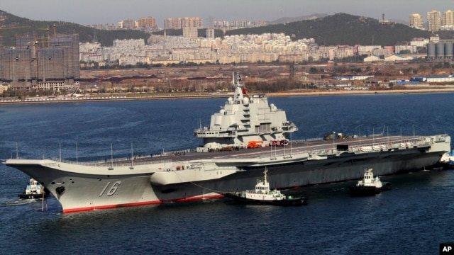 FILE - Chinese aircraft carrier Liaoning cruises back to port after its first navy sea trial in Dalian, northeastern China.