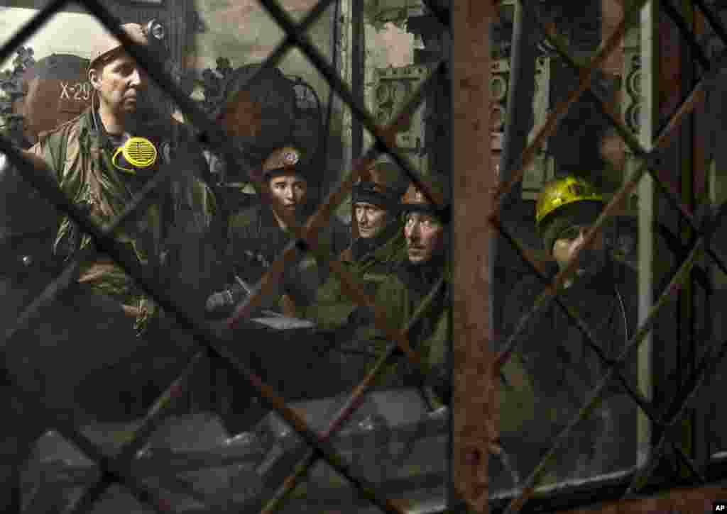Ukrainian coal miners prepare before going underground at the Zasyadko coal mine in Donetsk, March 4, 2015.