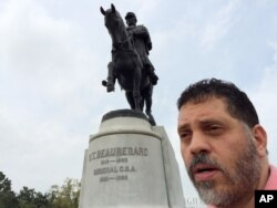 Michel-Antoine Goitia-Nicolas stands next to an equestrian statue of P.G.T. Beauregard, a Louisiana-born Confederate general, in New Orleans, March 16, 2016.
