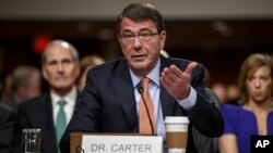 Ashton Carter, President Barack Obama's choice to be defense secretary, testifies before the Senate Armed Services Committee hearing on his nomination to replace Chuck Hagel as Pentagon chief, on Capitol Hill, Washington, Feb. 4, 2015.