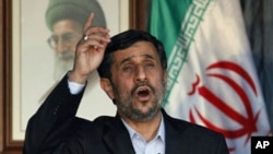 Iranian President Mahmoud Ahmadinejad, addresses a speech during a rally organized by Hezbollah in the southern border town of Bint Jbeil, Lebanon, 14 Oct 2010