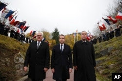 """FILE - French President Emmanuel Macron, center, and German President Frank-Walter Steinmeier left, attend a WWI ceremony at the World War I Vieil Armand """"Hartmannswillerkopf"""" battlefield in the Alsace region, eastern France, Nov. 10, 2017. The official at right is unidentified."""