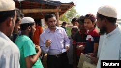 FILE - Rohingya Muslim leader Mohib Ullah speaks to other Rohingya people in Cox's Bazar, Bangladesh, April 7, 2019. Gunmen shot and killed Mohib Ullah in a refugee camp in southern Bangladesh Sept. 29, 2021, a U.N. spokesperson and a local police officia