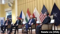 Czech, Hungarian and Polish Foreign Ministers Tomáš Petříček, Péter Szijjártó and Jacek Czaputowicz,(L-R) speak at event held at the Polish Ambassador's residence in Washington on April 4, 2019.