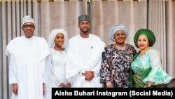 Shugaba Buhari tare da diyarsa da angonta a lokacin bukinsu.