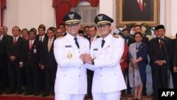 Anies Baswedan - Sandiaga Uno setelah dilantik di Istana Negara, Senin, 16 Oktober 2017.