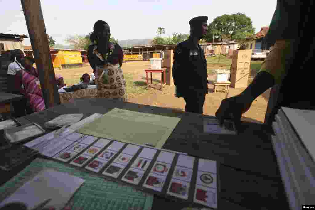 A man registers to vote at a polling station in Kibi, eastern Ghana, December 7, 2012.