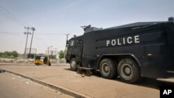 FILE - A police truck with water cannons stands guard outside the election commission offices in Kano, northern Nigeria, March 29, 2015.