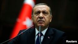 FILE - Turkey Prime Minister Tayyip Erdogan addresses members of parliament at the Turkish parliament in Ankara,Turkey.