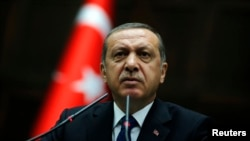 FILE - President Recep Tayyip Erdogan addresses members of parliament from his ruling AK Party (AKP) at the Turkish parliament in Ankara, June 3, 2014.