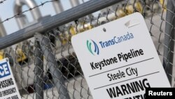 FILE PHOTO: A TransCanada Keystone Pipeline pump station operates outside Steele City, Nebraska, March 10, 2014.
