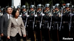 FILE - Taiwanese President Tsai Ing-wen inspects honor guard before a ceremony to mark the 92nd anniversary of the Whampoa Military Academy, in Kaohsiung, southern Taiwan, June 16, 2016.