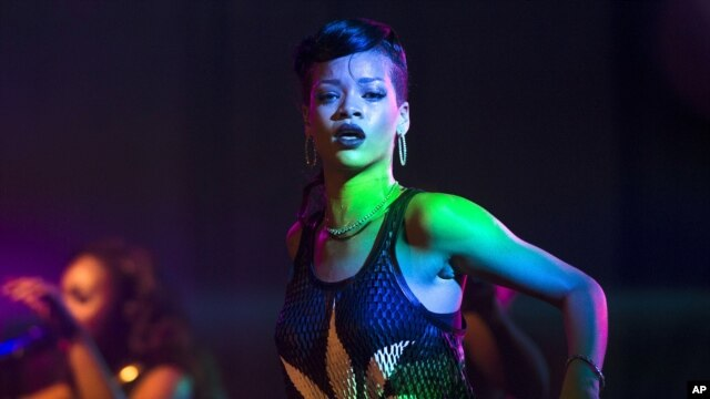 Barbadian singer Rihanna performs during the fifth stop of her 777 worldwide tour at the E-Werk club in Berlin, Nov. 19, 2012.