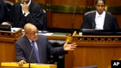 FILE - South African President Jacob Zuma answers questions from opposition party members during a parliamentary session in Cape Town, South Africa, March. 17, 2016. On Tuesday, Zuma survived a move by his own party to oust him as president.