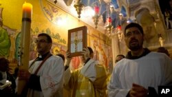 Christian clergymen participate in the Easter Sunday procession at the Church of the Holy Sepulchre, traditionally believed by many to be the site of the crucifixion and burial of Jesus Christ, in Jerusalem's Old City, Israel, March 27, 2016.