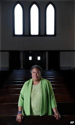 In this March 17, 2018 photo, Clara Ester stands in the Centenary United Methodist Church in Memphis, Tenn.