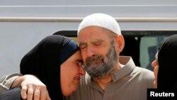 Giáo sĩ Hồi giáo Abu Qatada đoàn tụ với giao đình sau khi được tha bổng, ngày 24/9/2014.