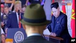 تصویری از رهبر کره شمالی و رئیس جمهوری آمریکا در یک شبکه خبری،ایستگاه قطار در سئول
