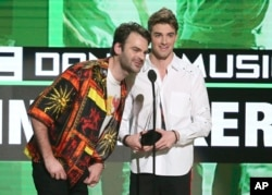 Alex Pall, left, and Andrew Taggart, of The Chainsmokers, accept the award for favorite artist - electronic dance music at the American Music Awards at the Microsoft Theater on Nov. 20, 2016, in Los Angeles.