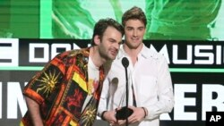 Alex Pall, left, and Andrew Taggart, of The Chainsmokers, accept the award for favorite artist - electronic dance music at the American Music Awards at the Microsoft Theater, Nov. 20, 2016, in Los Angeles.