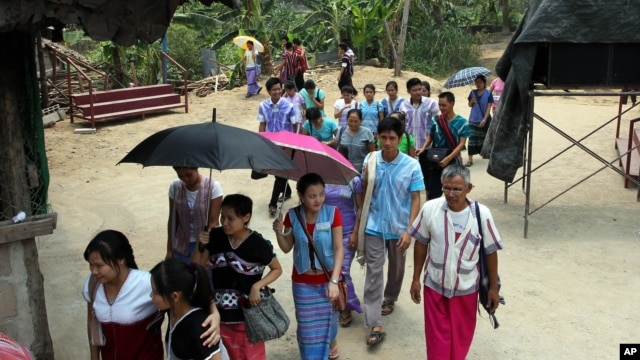 FILE - Karen refugees leave after a church service at Mae La refugee camp in Ta Song Yang district of Tak province, northern Thailand.