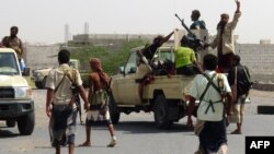 FILE - Yemeni pro-government forces gather on the eastern outskirts of Hodeida as they continue their battle to wrestle control of the city from Houthi rebels, Nov. 10, 2018.
